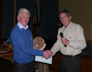 John presents Harry with 1st prize