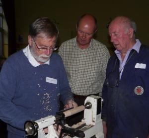 Dave Barlow shows Chris and Keith